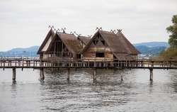 Stilt houses and wooden bridges in archaeological open-air museum on Lake Constance Bodensee in Unteruhldingen, Germany