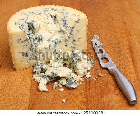 Stilton cheese on wooden cheese board
