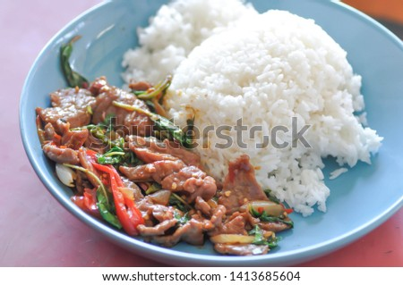 stir-fried beef or fried beef with sweet basil and rice