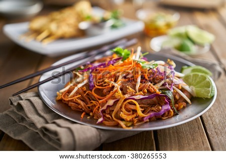 stir fried beef pad thai with color garnish and chopsticks #380265553