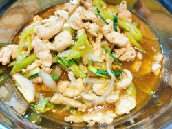 Stir Fried Chicken with Cashew Nuts and Chili Paste in the pan where the cook is stir-frying food to sell to customers It is a delicious and nutritious Thai food with many ingredients such as sweet re