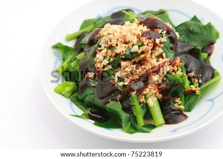 Stir Fried Chinese Brocolli with oyster sauce isolated on white