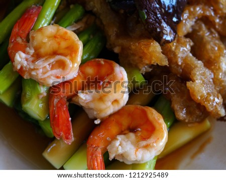 Stir fried Chinese Hong Kong kale, shrimp, fish maw and mushroom in oyster sauce. Chinese food.
