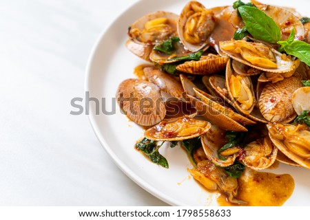 Stir Fried Clams with Roasted Chilli Paste - Asian food style Stock photo ©