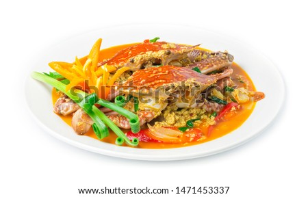 Stir fried Crab in curry powder sauce and egg fusion Thai food and Chinese food style decorate with chili and spring side view