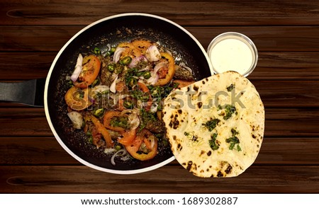 Stir Fried Juicy Kabab with the Delicious Taste of Tomato and onions served with Aroma of Home made Garlic nan and Afghani Sauce layered with butter and Garlic  Stok fotoğraf ©