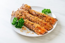 Stir Fried Mantis Shrimp with Garlic on white plate