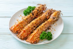 Stir Fried Mantis Shrimp with Garlic on white plate