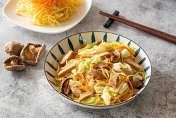 Stir fried noodle with vegetable and shiitake mushroom for Chinese vegetarian festival
