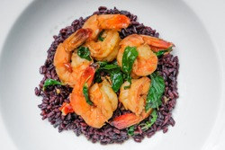 stir fried shrimp in hory basil on cooked rice - thai food.