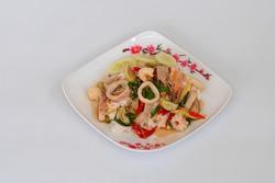 Stir fried spicy basil leaves with pork, squid, shrimp, chilli
