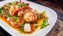 Stir-Fried Spicy Scallops Hot meals mixed vegetables in sauce  to Spicy taste And the delicious smell of seafood . Recommended dishes in Thailand