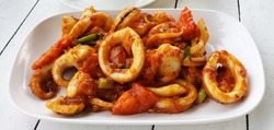 Stir-fried squid with roasted chili paste.