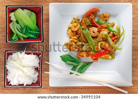 Stir Fried Thai style prawns in chili and basil paste sauce, peppers, with Bok Choi and steamed rice #34991104