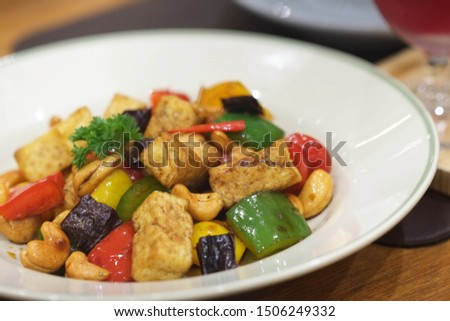 Stir-fried tofu and cashew nut with dried chilli, red bell pepper, spring onion and onion vegetarian menu vegetarian festival