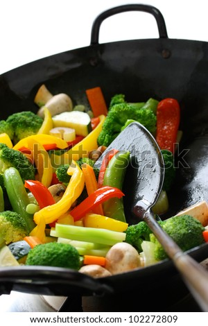 stir fried vegetables in a chinese wok #102272809