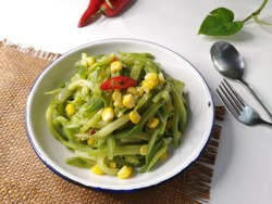Stir fry chayote squash with corn is a home-cooked vegetable dish common in Indonesia, also known as tumis labu siam