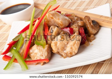 Stir fry chicken with sweet peppers and mushrooms - stock photo