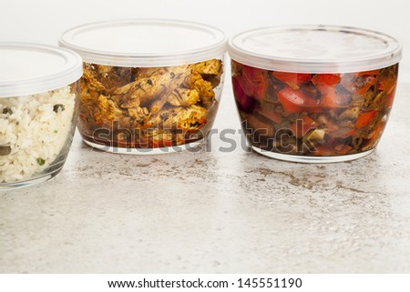 stir fry dinner meal or leftovers stored in glass containers