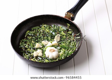 Stir frying spring onion and garlic