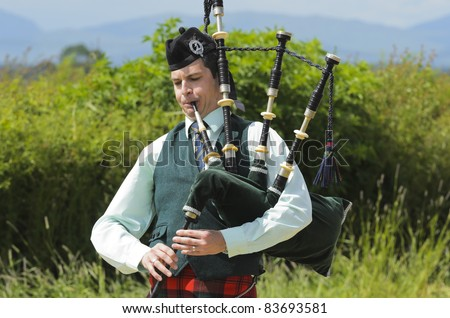 STIRLING, SCOTLAND, UK - JULY 10: An unidentified Piper competing in solo piping competition during Stirling Highland Games on July 10, 2011 in Stirling, Scotland, UK.