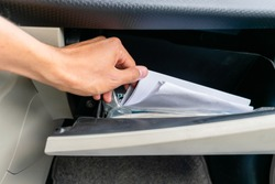 stirring papers in a glove box