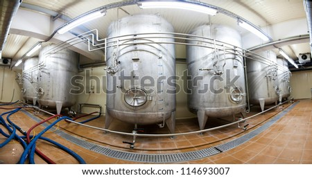 Stitched Panorama Large dural tank sludge beer before bottling plant