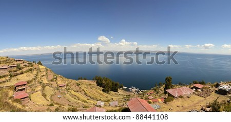 Stitched Panorama of Houses on Taquile Island overlooking lake Titicata. Highest Navigable Lake in the world