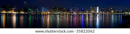 Stitched panorama of the city of Rotterdam and Mass River. Night scene