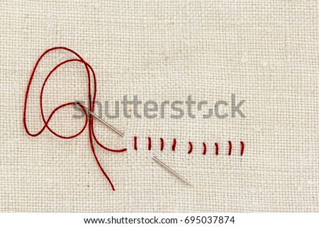 Stitches and needle - proverb: One stitch in time saves nine. - Shutterstock ID 695037874