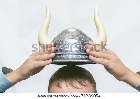 Stock broker. Bull speculation concept. Agressive business strategy. Business man holding a bull hat with horns above his head. Best stock trader.