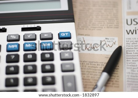 Stock chart analysis, calculator, with pen, horizontal orientation. charts, analysis, ups and downs, shallow depth of field