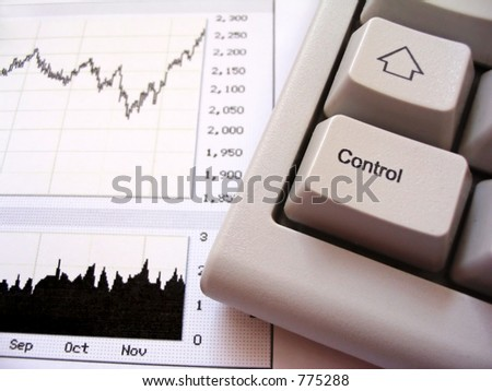 Stock chart and keyboard, control key in foreground - stock photo
