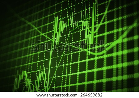 Stock chart graph of market share prices of company. Live on monitor desktop screen monitor. Business background. Green color.