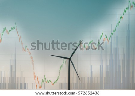 Stock exchange market trading graph over the screen of Wind turbine farm on  the trading graph background, business marketing trade concept