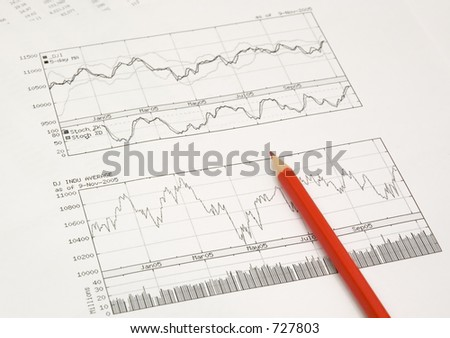 stock graphs and red pencil - stock photo