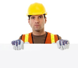 Stock image of construction worker holding blank sign withy copy space
