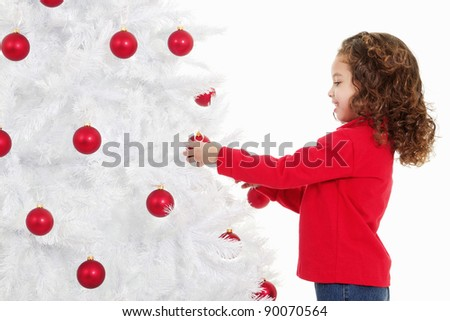 Stock image of cute little girl decorating a christmas tree