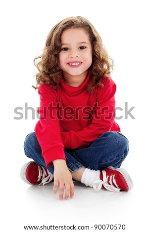 Stock image of cute little girl sitting and smiling, isolated on white with shadow on floor
