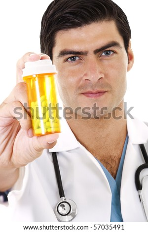 Stock image of doctor holding a bottle of prescription drugs