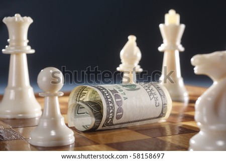 stock image of dollar bill on a chess board