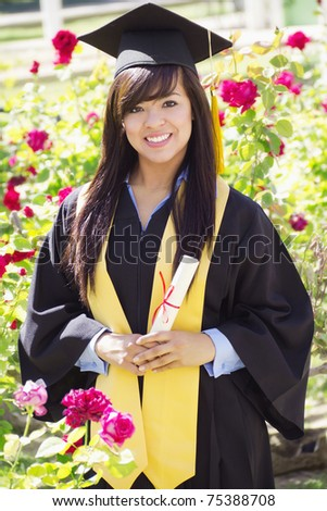 Stock image of happy female graduate, outdoor setting,