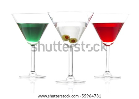 Stock image of Martinis over white background, includes, appletini, red apple martini  and dry martini, colors based on the flags from Mexico, Ireland, and Italy.