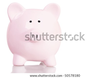 Stock image of pink piggy bank with copy space over white background