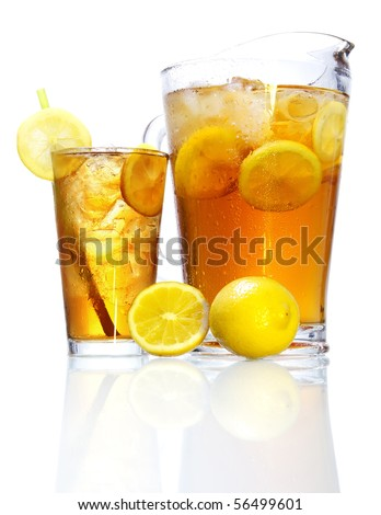 Stock image of pitcher and glass of Iced tea over white background with reflection on bottom, could be Long Island Iced Tea. Find more cocktail and prepared drinks images on my portfolio.