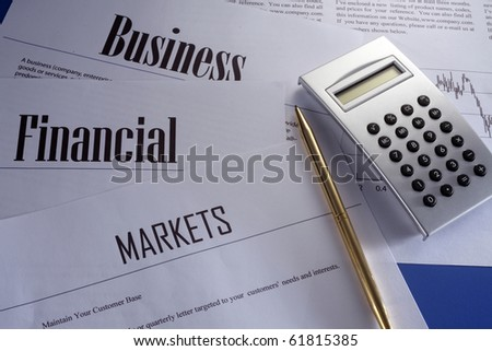 stock image of the calculator of business report
