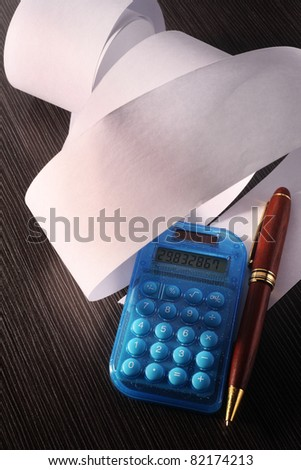stock image of the rolled of paper and calculator