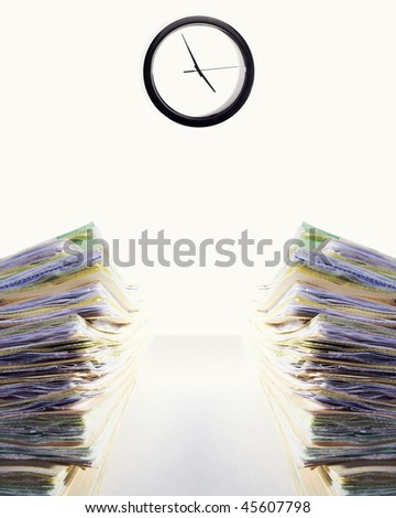 Stock image of two stacks of paperwork on desk, clock says it's almost time to leave...