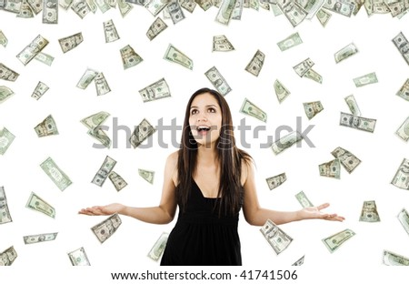 Stock image of woman standing with open arms amidst falling money