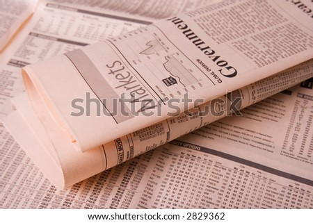 Stock market and financial newspaper close up